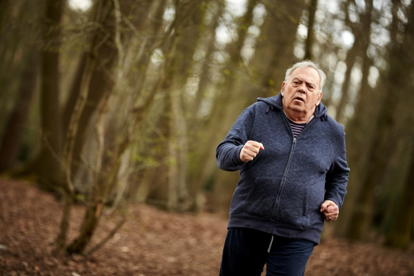 Elderly man running in wood